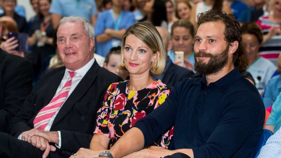 Northern Irish actor Jamie Dornan (right) with his sister Jessica Dornan Lynas and father Dr Jim Dornan, during the Pancreatic Cancer charity NIPanC launch at the Mater Hospital in Belfast.