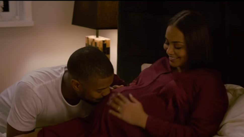 Michael B. Jordan Cradles Lauren London's 'Baby Bump' In New 'Without Remorse' Trailer.jpg
