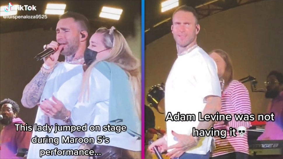 Watch Adam Levine React to Fan Crashing the Stage During Maroon 5 Concert.jpg