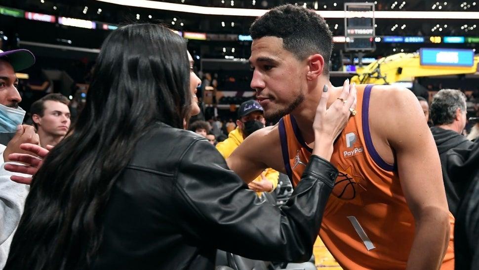 Devin Booker Kisses Kendall Jenner Courtside in Rare PDA Moment.jpg
