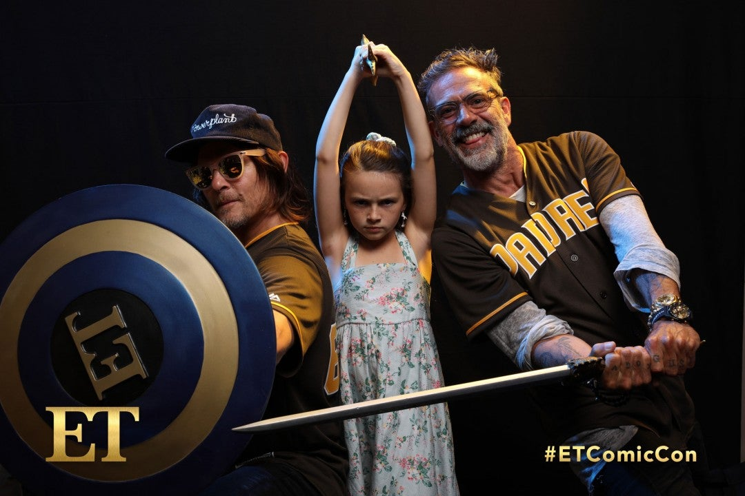 Norman Reedus, Cailey Fleming and Jeffrey Dean Morgan at et booth at comic-con