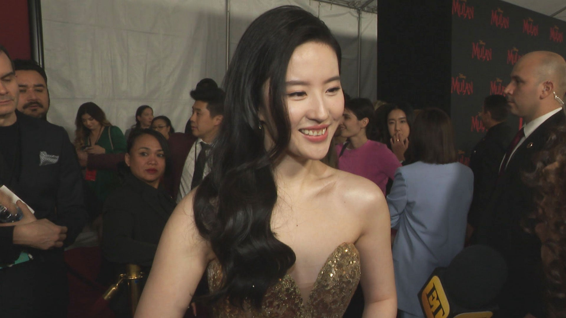 Mulan Star Yifei Liu On Her Regal Gold Phoenix Gown At Hollywood Premiere Exclusive Entertainment Tonight